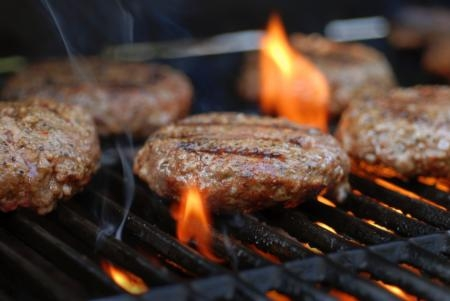 photo of hamburger patties being grilled