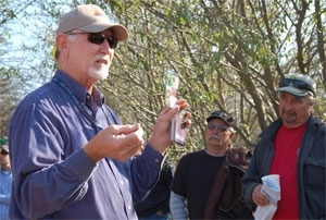Walt Bentley speaks to growers at a field day.