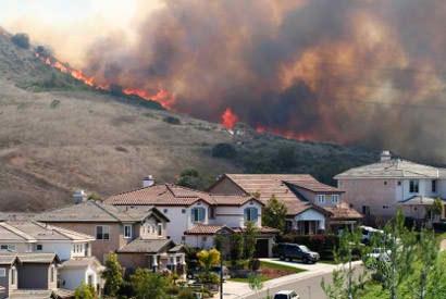 Fires burn across the hillside near homes in Portola Hills in Orange County.