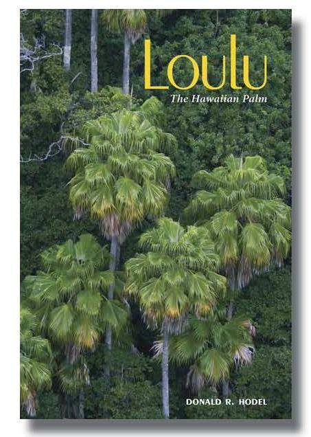 Five Loulu palm trees in a verdant landscape.