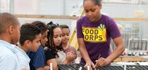 A previous FoodCorps service member working with garden seedlings in a greenhouse. for ANR news releases Blog