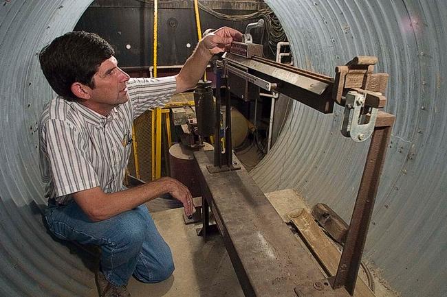 Scott Johnson in the underground access chamber of the weighing lysimeter.