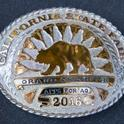 The first place team will win $7,500 and this custom rodeo-style belt buckle.