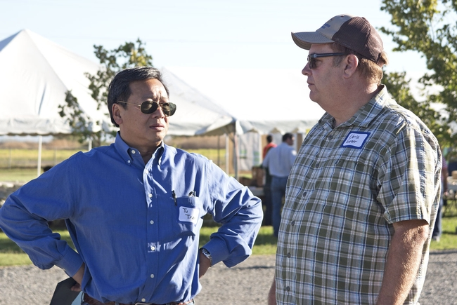 Tu Tran, left, UC ANR vice president for business operations, and Chris Greer, UC vice provost of Cooperative Extension, attended the Rice Field Day in Biggs to announce the creation of the new UCCE Presidential Chair for California Grown Rice.