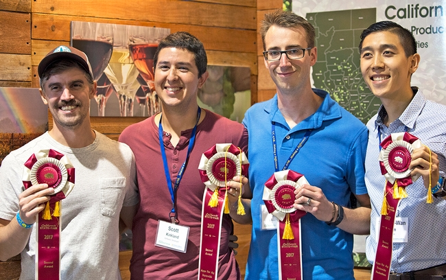 From left, Calvin Doval, Scott Kirkland, John Knoll and Shiang-Wan-Chin's Greener app, which diagnoses plant diseases from a photo, took second place.