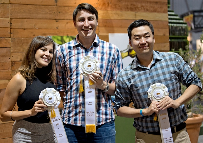 From left, Heather Lee, Will Mitchell and Zhenting Zhou finished third with their Farm Table app, which promotes agritourism.