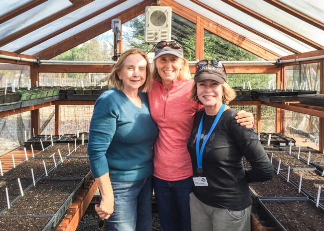 Three Master Gardeners  arm-in-arm in the greenhouse at Our Garden