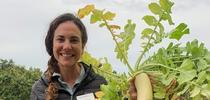 Alli Fish holding a radish. for Climate Smart Agriculture Blog