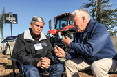 Alan Wilcox, left, and Jeff Mitchell debate the challenges and opportunities for conservation tillage.