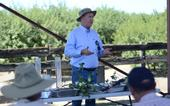 Veteran UC Cooperative Extension Advisor, Dan Munk, of Fresno County, leading discussion of mid-season cotton crop and water management, at the July 24th public field day at Pikalok Farms in Mendota, CA.