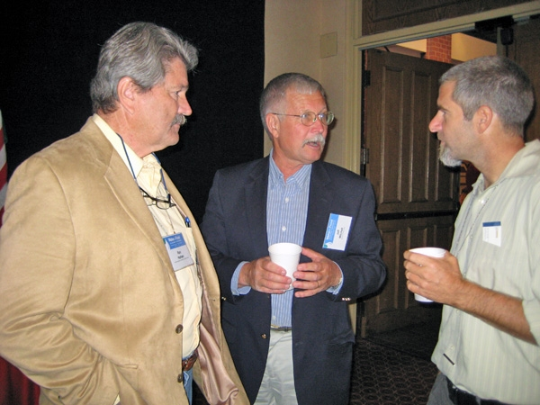 CASI executive board member Ron Harben (left), UC Cooperative Extension cropping systems specialist Jeff Mitchell (center) speak with Paul Hicks of Catholic Relief Services during a break at the Water for Food Conference.