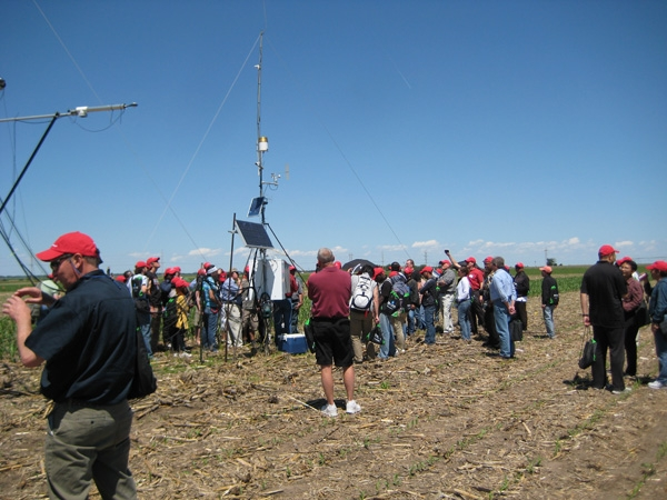 Tour participants gather around the $55,000 evapotranspiration research equipment.