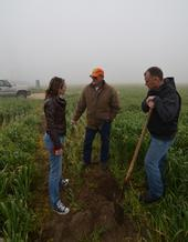 Amelie Gaudin discussing ecological practices with farmers.