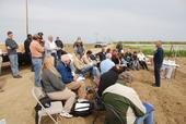Farmers gather for training at a previous conservation agriculture field day. A half-day workshop titled 'Benefits of Soil Management for Farming Systems