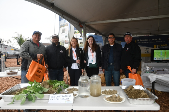 UCCE's Mohammad Yaghmour, UCCE Kern County (second from right) and Jaime Solorio, UC West Side REC, Five Points, CA (far right) visit the CASI / NRCS display site at the World Ag Expo in Tulare, CA - February 13, 2019