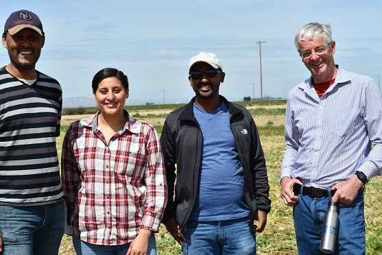 Teamrat Ghezzezei, Jennifer Alvarez, Samuel Ayala, of UC Merced and Jan Hopmans of UC Davis (left to right), tour the NRI Project field in Five Points, CA April 1, 2019