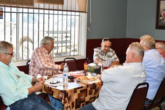 Rick Reed (center top) along with Frank Coelho (far left) and James Avila (second from left) at El Ranchero Café in Five Points, CA discussing farming in California's West Side compared to in Georgia