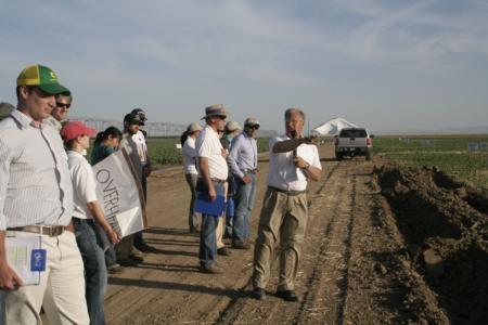 Jeff Mitchell addresses farmers at last year's twilight CT field day.