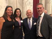 Elizabeth Sugarman, Sissy Sugarman, Ray Kerins of Bayer Corporation, and Shawn Sugarman at the Congressional Gold Medal award ceremony