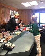 Board Chair, Supervisor Karl Rodefer shaking the hand of Belle, Tuolumne County Ambassador