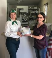 Olivia delivering 100 face masks to the Santa Barbara Farm Bureau.