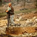 Chris and Nancy Brown embrace while searching through the remains of their home, leveled by the Camp Fire in Paradise, California Noah Berger/AP