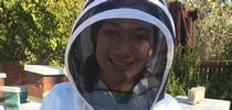 Capriana in her bee suit for California 4-H Grown Blog