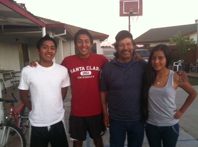 Eleazar Sosa, second from right, told Buter he hopes his son (second from left) acquires experiences that will lead to a career beyond farmwork. The three youths in the picture are Sosa's children, left to right, Roosevelt, Randy and Jocelyn.