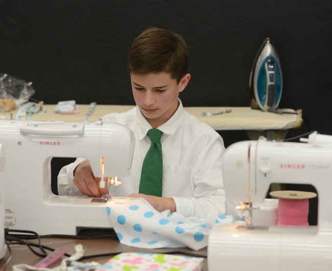 """Ryan Anenson of the Tremont 4-H Club, Dixon, won a gold award for his presentation on """"Robotic Engineering"""" and then sewed a flannel blanket for the """"Cuddle Me Close"""" project. (Photo: Kathy Keatley Garvey)"""