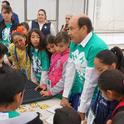 Raúl Nuño, a member of the Baja California Agriculture Department, helps children prepare to plant seeds. (Click the photos to download high-resolution versions.)