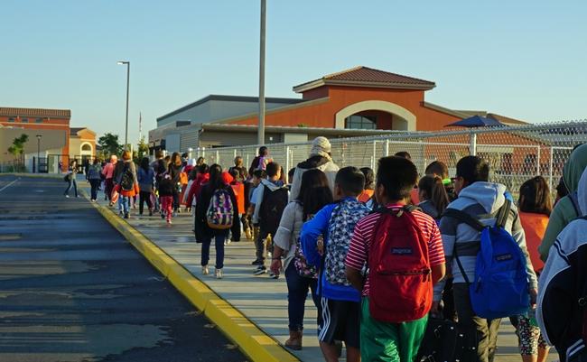 Students arrive at Virginia Lee Rose Elementary School.