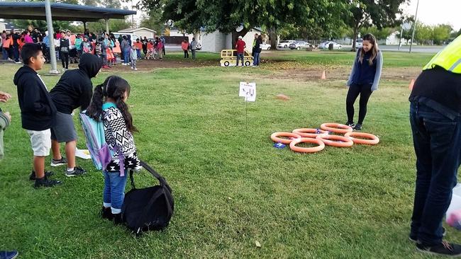 UC CalFresh nutrition program coordinator Carissa Villanueva supervises a bean bag toss activity at McNally Park before the walk to school.