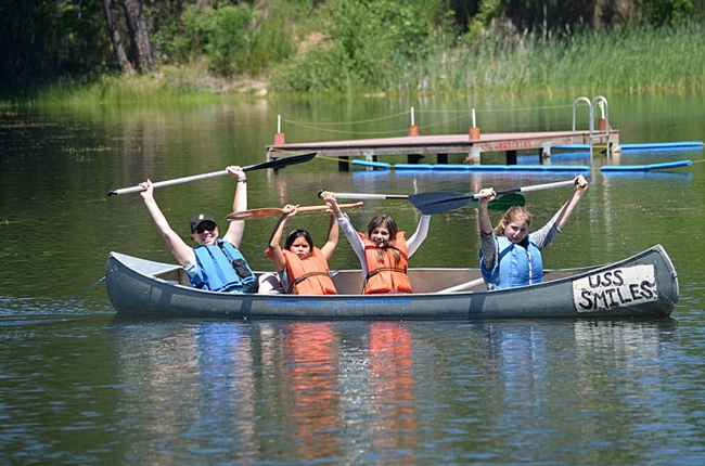 Stephanie, a teacher from Mills Middle School in Rancho Cordova, and happy paddlers are all smiles. Though learning is paramount at 4-H On the Wild Side, fun is never compromised. (Photo: Marianne Bird)
