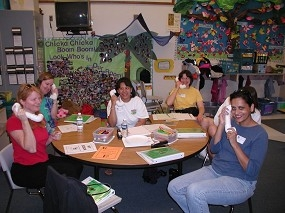 Parents of preschoolers practice using sound-a-phones they made as part of the Off to a Good Start series.