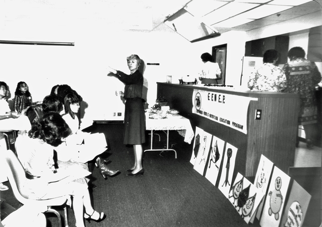 Home economist Mary Marshall conducts EFNEP training session for refugees enrolled in English class. (November 1982)