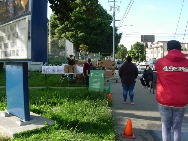 Parents practiced social distancing while picking up plants in Oakland.