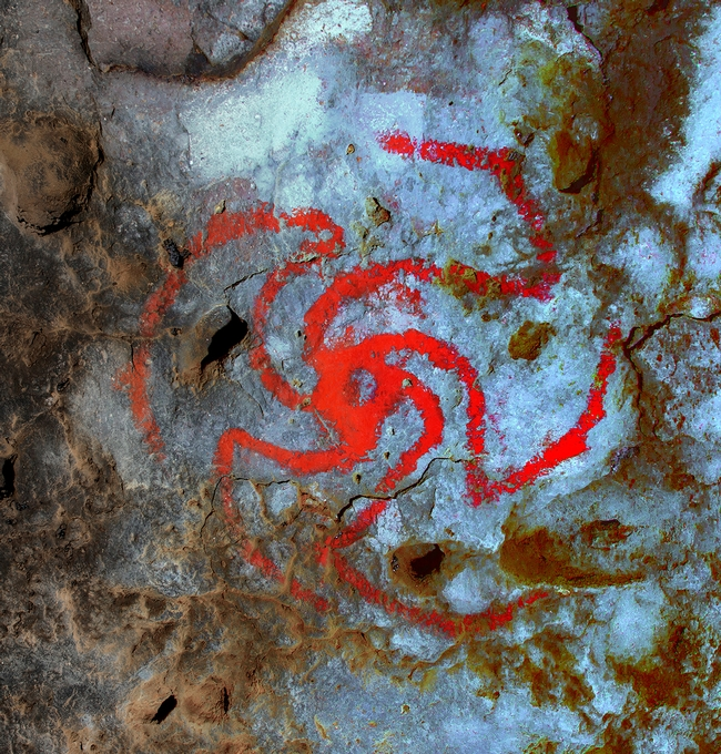 Scientists believe a red pinwheel painted in a Kern County cave by Native Americans depicts a Datura flower swirling open.