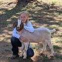 Wolf Creek 4-H member Kylee and her Boer goat Luther.