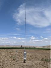 Figure 1. UCCE weather station with a 30-foot mast to measure the inversion condiitons.