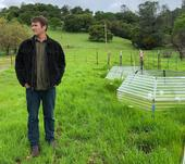 SFREC director Jeremy James stands next to a small chamber designed to simulate effects of warming air and soil temperatures on rangeland grasses. The poly carbonate hexagons slow rates of heat loss from plots, allowing scientists to artificially warm plants and soils in the chambers. (Photo: Linda Forbes)