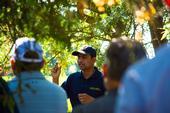 UCCE Integrated Pest Management advisor Jhalendra Rijal addresses farmers, pest control advisers and UC Master Gardener volunteers in a Turlock almond orchard. (Photo: Michael Rosenblum, UCCE Stanislaus County)