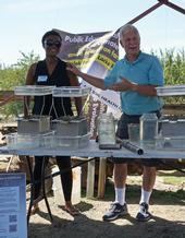 UCCE climate-smart educator Esther Mosase, left, and UCCE specialist Jeff Mitchell at the field day. Mosase is a native of Botswana, the African country where Mitchell served in the Peace Corps before she was born.