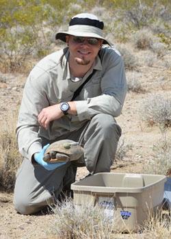 Professor Brian Todd, UC Davis, with a Mojave desert tortoise.