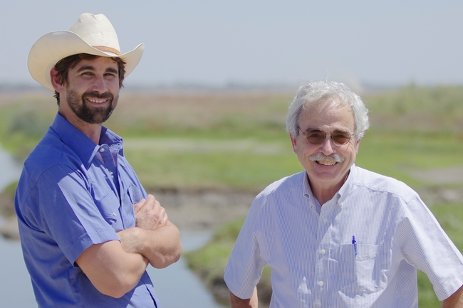 Jacob Katz (left), director of California Trout's salmon and steelhead initiatives, and Professor Peter Moyle (right) are pictured at the Yolo Bypass, where their research is evaluating the importance of the area for rearing juvenile salmon.