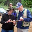 John Battles and SNAMP participant Lynn Lorenson discussing a tree core sample.