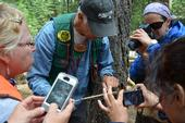 Mike De Lasaux shows FIT participants the tree rings in a core sample.