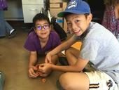Students try to put together the pieces of broken pottery they have located and mapped. It's not always easy when others have taken some of the pieces as keepsakes.