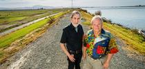 Professors and Delta Independent Science Board members Vincent Resh (right) and Richard Norgaard stand on a levee on Sherman Island along the Sacramento River. (Photo: Edward Caldwell) for Green Blog Blog