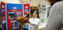 Jarred Burkett, 10, of the Sherwood Forest 4-H Club, Vallejo, talks about his chicken, Frostbite, at the Solano County 4-H Presentation Day, held recently in Dixon. (Photo by Kathy Keatley Garvey) for Green Blog Blog