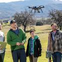Professor Justin Brashares (center) and members of his lab utilize tagging, drones, and GPS technologies to track the movement of carnivores and their prey. (Jim Block)